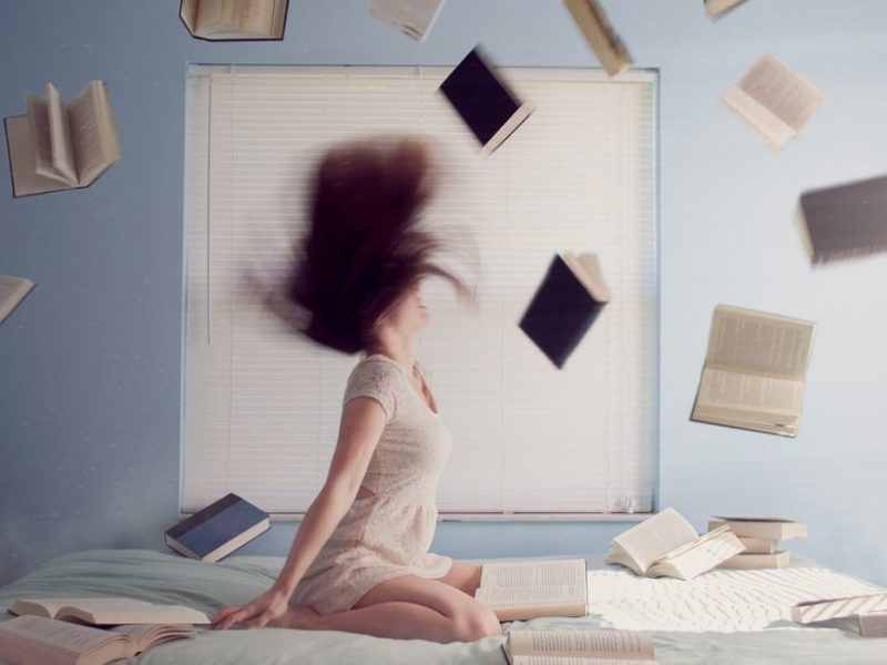 Frustrated women throwing books