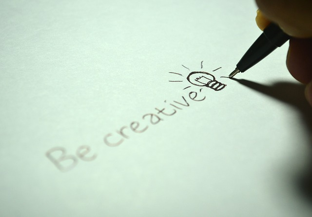the words Be Creative written on paper