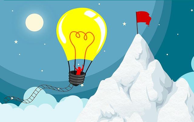 light bulb flying over a mountain