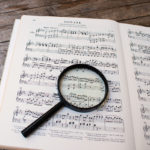 Score with magnifying glass